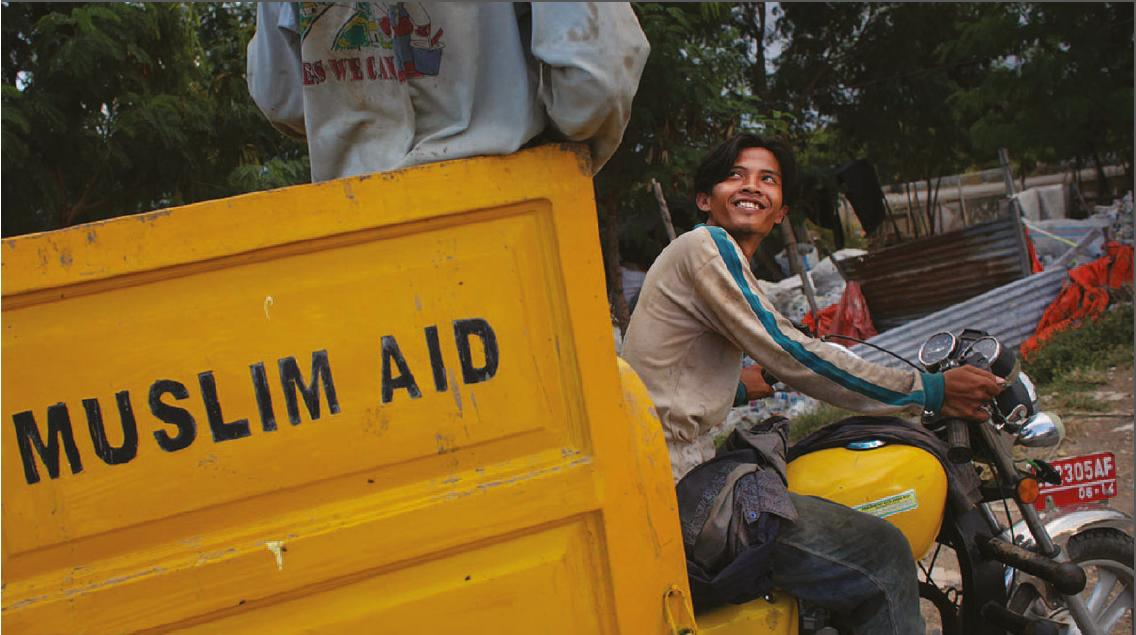 "Image of motorbike pulling a cart of ""Muslim Aid"" used in the Communication Challenge article"